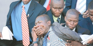 Odhiambo Owuor being brutalized by security guards