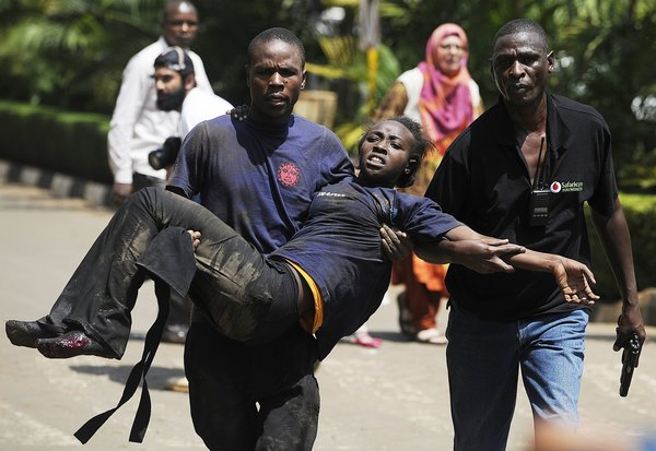 The injured being carried away from Westgate