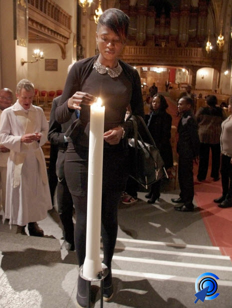 Lighting a candle during the Westgate shooting memorial service in Stockholm: Friday, 27th September 2013