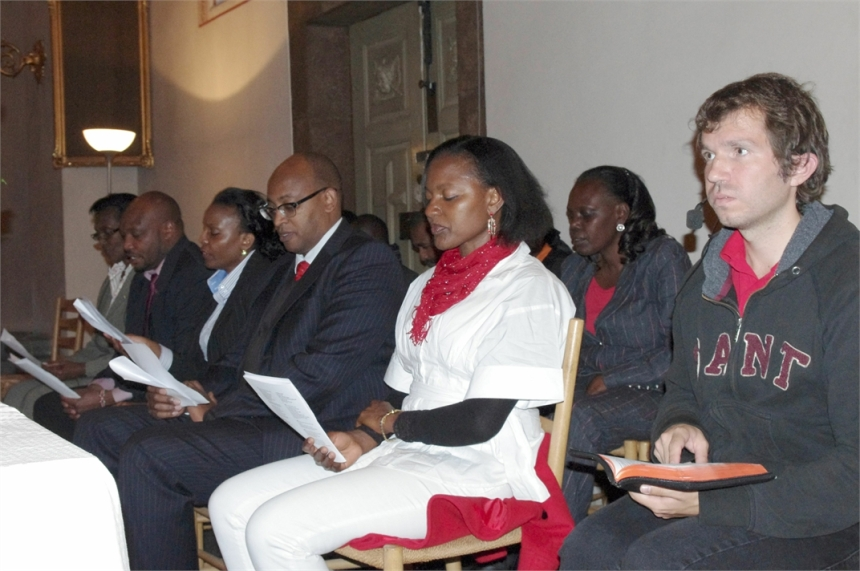 Kenyan Ambassador to Scandinavia together with wife pray for for Westgate dead at St Klara Church in Stockholm